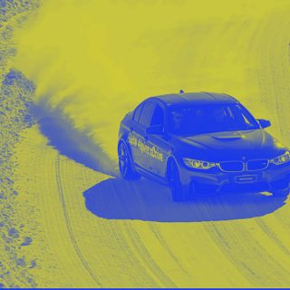 image shows car on Swedish icy driving course